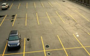 Aerial view of a parking lot with cars