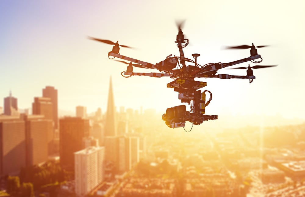 Silhouette drone Flying over San-Francisco city on blurred background