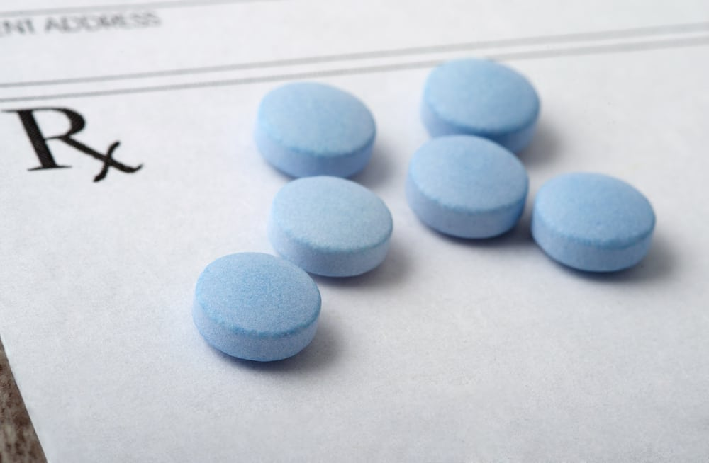 pills on an rx prescription pad