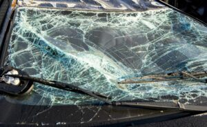 A shattered windshield from a crashed car